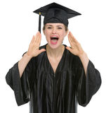 Female graduation student shouting Royalty Free Stock Photos