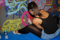 Female graffiti artist. A view of a female graffiti artist during Mulafest in Madrid 2012 Royalty Free Stock Image