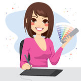 Female Graphic Designer. Beautiful female graphic designer showing pantone color chart palette Royalty Free Stock Photography