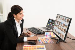 Female graphic designer in office Royalty Free Stock Image