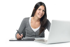 Female graphic designer smiling as she does her edits Royalty Free Stock Photography