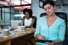 Female graphic designer using digital tablet Stock Image