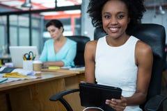 Female graphic designer using digital tablet Royalty Free Stock Image
