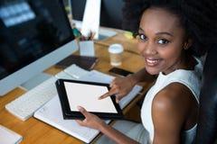 Female graphic designer using digital tablet Stock Photo