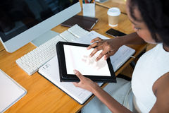 Female graphic designer using digital tablet Royalty Free Stock Photography