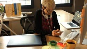 Female graphic designer using mobile phone stock video footage