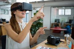 Female graphic designer using the virtual reality headset. In creative office Stock Photography