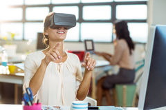Female graphic designer using the virtual reality headset. At office Royalty Free Stock Image