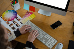 Female graphic designer working at desk Stock Photography