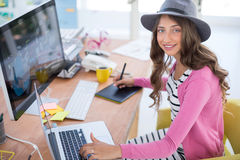 Female graphic designer working at desk in the office royalty free stock photos