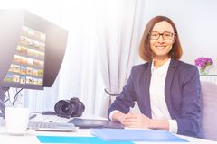 Female graphic designer working in the office royalty free stock photography