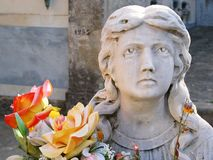 Female Graveyard Statue. An old female statue at a local graveyard in Italy Stock Images