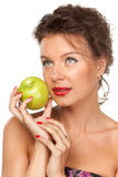 Female with green apple Royalty Free Stock Photography