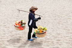 Female greengrocer fruit seller in Asia Royalty Free Stock Photography