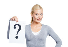 Female keeps paper with question mark. Female in grey sweater keeps paper with question mark, isolated on white Royalty Free Stock Photo