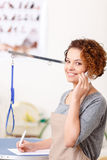 Female groomer making an appointment Royalty Free Stock Photography