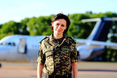 Female guard at the airport. Girl in camouflage border guard at the airport stock photos