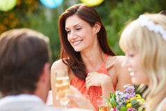 Female Guest At Wedding Reception. Outdoors Having A Good Time Royalty Free Stock Images