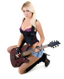 Female and guitar Stock Images