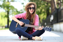 Female with guitar royalty free stock images