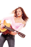 Female guitar player. Beautiful girl with guitar in rock n roll style Royalty Free Stock Photos