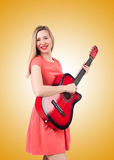 Female guitar player against the gradient. The female guitar player against the gradient Royalty Free Stock Image