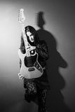 Female guitar player black and white royalty free stock image