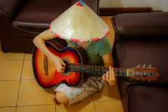 Woman guitar player Stock Image