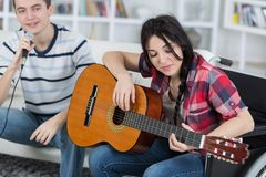 Female guitarist male singer. Female guitarist the male singer Stock Photo