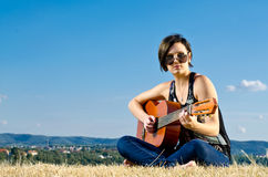 Female guitarist outdoors Royalty Free Stock Image