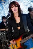 Female guitarist playing at a concert Royalty Free Stock Photography