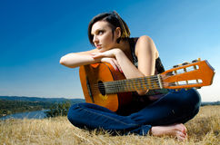 Female guitarist posing outdoors Stock Photos
