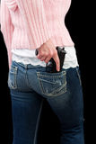 Female with a gun. Female model body shot holding a gun isolated on a black background Royalty Free Stock Photography