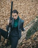 Female with a gun. Hunter woman. Hunter with a backpack and a hunting gun. A hunter with a hunting gun and hunting form. To hunt royalty free stock photography