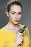 Female gun power concept for gorgeous young woman Royalty Free Stock Photo