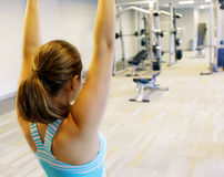 Female in gym class, relaxation exercise or yoga class Royalty Free Stock Images