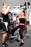 Female gym exercise trainer Royalty Free Stock Photography
