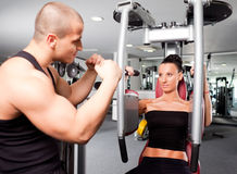 Female in the gym with trainer Stock Photography