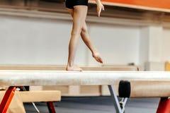 Female gymnast. Exercises on balance beam female gymnast competitions in gymnastics royalty free stock image