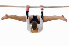 Female gymnast performing on bar, cut out Stock Photography