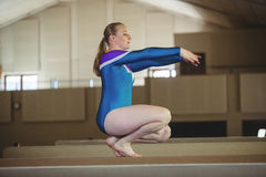 Female gymnast practicing gymnastics on the balance beam Royalty Free Stock Photography