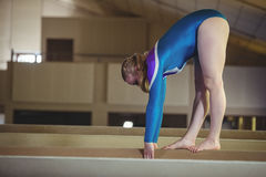 Female gymnast practicing gymnastics on the balance beam Stock Image