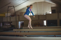 Female gymnast practicing gymnastics on the balance beam Stock Photography