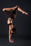 Female gymnast stretching stock photo