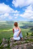 Female gymnastics on the rock Royalty Free Stock Image