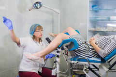 Female Gynecologist During Examination In Her Office Stock Photography