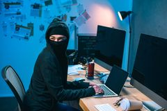 female hacker in mask developing malware royalty free stock photo
