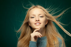 Female with hair fluttering in the wind Stock Photo