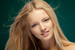 Female with hair fluttering in the wind Stock Photos