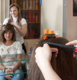 Female hair stylist is working Royalty Free Stock Photography